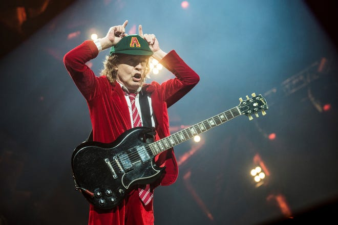 """Angus Young, of AC/DC, performs at Nationwide Arena on Sept. 4, 2016, in Columbus, Ohio.  After 47 years, the band released its 17th studio album, """"Power Up,"""" on Friday."""
