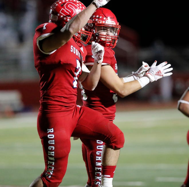 Sundown's EJ Hernandez (7) celebrates his touchdown with teammate Logan Boggs (31) during the first half of a Class 2A Division I bidistrict game Thursday against Farwell at Lobo Stadium in Levelland.