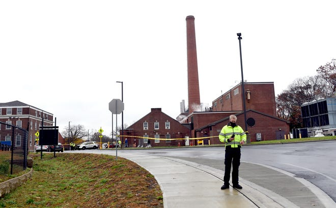 Veterans Affairs Police guard the entrance to a maintenance facility after an apparent steam explosion in a maintenance building at a Veterans Affairs hospital in West Haven, Conn., on Friday. Two workers were killed while repairing a steam pipe in a maintenance building, officials said.