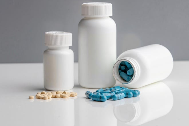 Polycaps, right, pills from India-based Cadila Pharmaceuticals that contains one cholesterol and three blood pressure medicines, and 75mg aspirin pills were used in the International Polycap Study 3 (TIPS-3). On Friday, researchers said the cheap, daily pill taken with low-dose aspirin can cut the risk of heart attacks, strokes and heart-related deaths by nearly one third. (Georgia Kirkos/McMaster University via AP)
