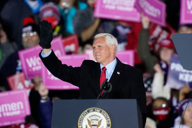 Vice President Mike Pence acknowledges the crowd during a campaign event Nov. 2 in Grand Rapids, Mich.