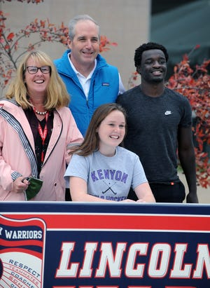 Many Lincoln-Sudbury Regional High School seniors signed their National Letters of Intent at a ceremony outside the high school Thursday.  Pictured, Kenyon College-bound Sarah Molloy, with mom Judy Merra, brother James, and dad Morgan.