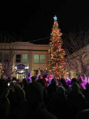 People gather in 2019 to see the lighting of Mount Shasta's Christmas tree in front of the Mount Shasta Police Department and city hall.