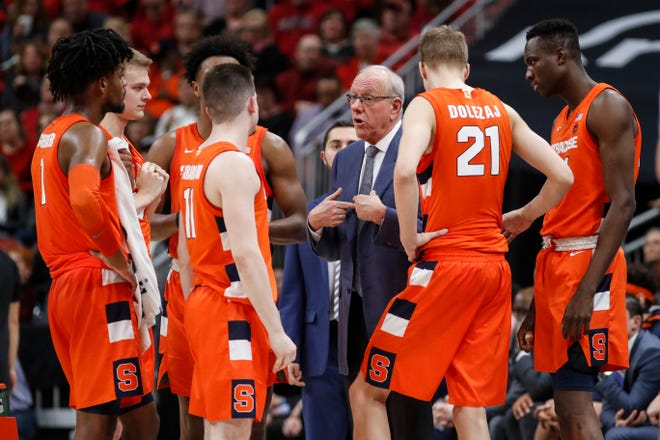 Syracuse head coach Jim Boeheim talks his players during a game last February.
