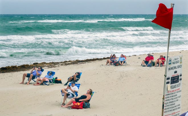 Beachgoers line up their chairs against the wind earlier this month at Midtown Beach.