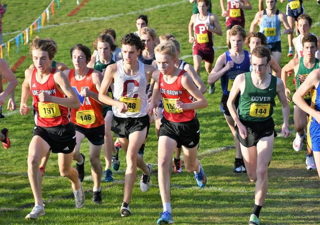 Coe-Brown's Luke Tkaczyk, left, and Aidan Cox, center, run during the early stages of the NHIAA Meet of Champions boys cross country race last Saturday in Nashua. To the right is Dover's Tyler Sheedy.