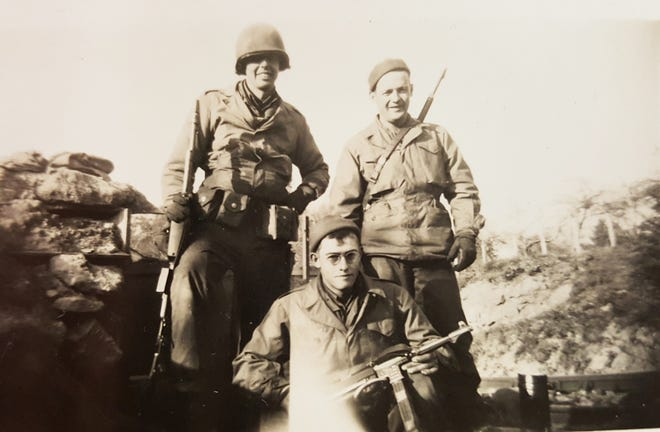 Allen Brackett, in front wearing glasses, with fellow soldiers of the 66th Infantry Division in France during World War II. [Courtesy Photo]