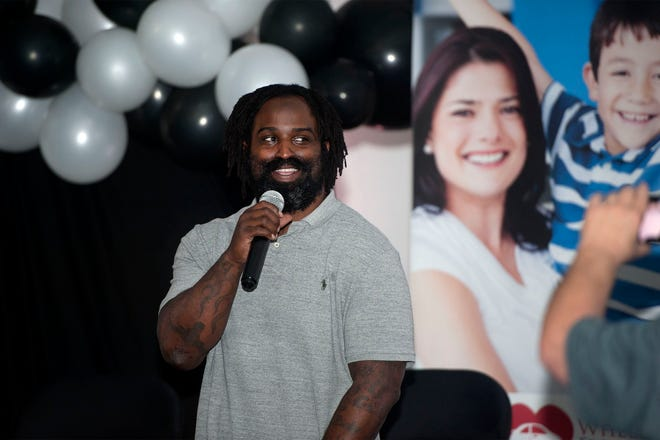 Former Dolphins running back Ricky Williams speaks during the second annual Cars and Conversation event in Delray Beach on Thursday night.