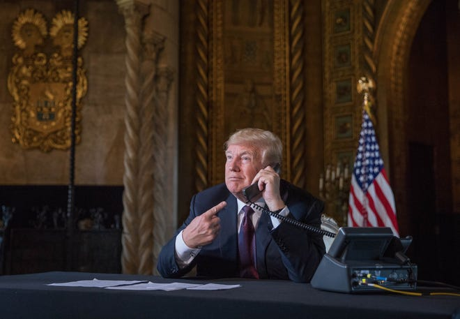 President Donald Trump talks to military troop via a teleconference from Mara-a-Lago in Palm Beach on Thanksgiving Day 2018. [GREG LOVETT/palmbeachpost.com]