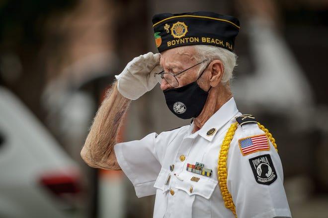 Les McKinzie, a member of American Legion Post 164, in Boynton Beach, salutes during a Veteran's Day ceremony at Thomas Kaiser Veteran's Memorial Park in Boynton Beach on Nov. 11, 2020.