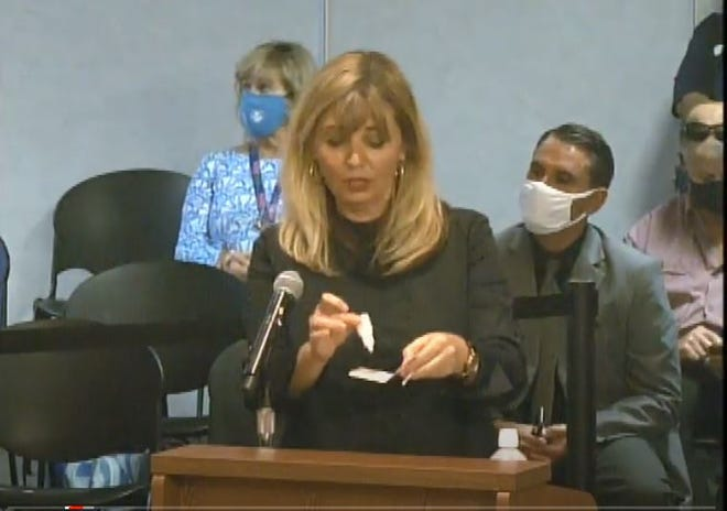 Dr. Belma Andric, chief medical officer for the Health Care District of Palm Beach County, demonstrates how a rapid test to be used in public schools.