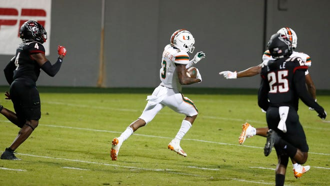 Miami's Mike Harley outruns the N.C. State defense for a 54-yard game-winning touchdown reception Friday at Carter-Finley Stadium in Raleigh, N.C.