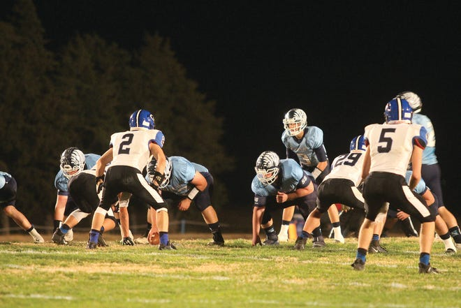 Skyline High School freshman quarterback Braden Berens calls the play for the Thunderbird offense in a post-season battle against Goessel that had both teams pulling out all the stops. It was a close game for all of regulation and throughout both overtime periods as well.