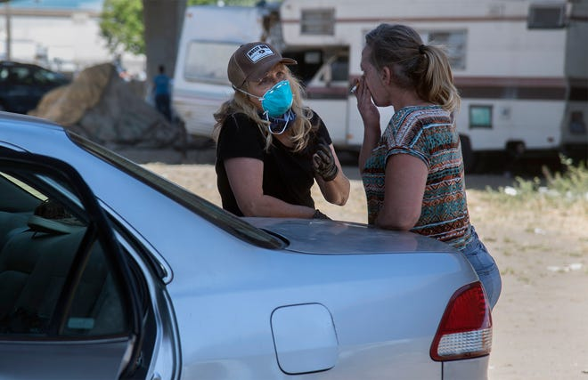 San Joaquin County District Attorney Tori Verber-Salazar, left, talks to a homeless woman while doing outreach for COVID-19 virus testing at a homeless encampment under the Crosstown Freeway in May. Free pop-up COVID-19 tests will be available from 2 p.m. to 5 p.m. Friday Nov. 13 at Lincoln Center and from 2 p.m. to 4 p.m. Saturday at Woodbridge Crossing in Lodi.