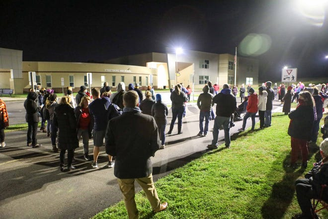 A crowd assembled outside Streetsboro High School while negotiations take place inside between the Streetsboro Education Association and the school district.