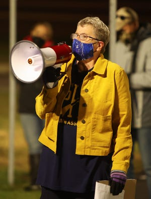 Lynne Rumsey, a lifelong resident of Streetsboro, came out to show her support for the Streetsboro teachers and staff during the vigil held outside the high school while negotiations took place inside.
