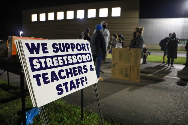 Streetsboro teachers and staff picked up boxes to remove their personal items from schools during a vigil shortly before the Nov. 18 strike deadline. A tentative deal was reached the day after the vigil.