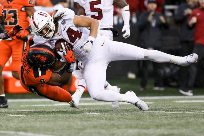 Oregon State linebacker Hamilcar Rashed Jr. tackles Stanford tight end Colby Parkinson (84) in a Sept. 28, 2019, game at Reser Stadium in Corvallis.