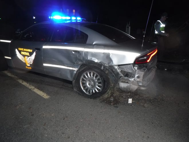 An Ohio Highway Patrol trooper was injured when a man driving a pickup struck him Thursday evening. The photo, provided by the patrol's Canton post, shows the damage to the trooper's cruiser.