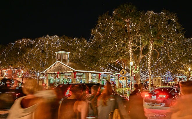 People gather on the Plaza de la Constitucion in St. Augustine during the city's annual Nights of Light event in 2019.