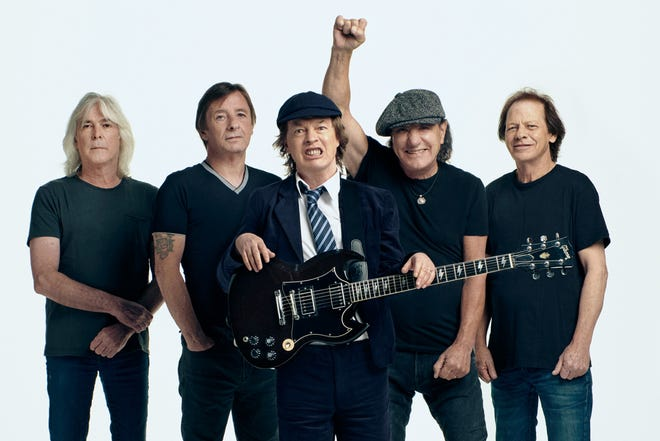 "AC/DC's new album ""Power Up"" features the band's classic ""Back in Black""-era lineup of, from left, Cliff Williams (bass guitar), Phil Rudd (drums), Angus Young (lead guitar) and Sarasota resident Brian Johnson (lead vocals). Stevie Young, far right, fills in on rhythm guitar for his uncle Malcolm Young, who died in 2017."