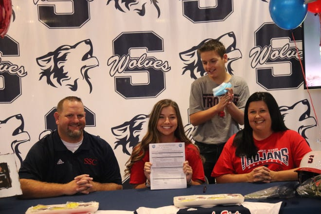 Shawnee High School softball player Hallie Wilson happily displays her national letter-of-intent to play softball at Seminole State College next season.