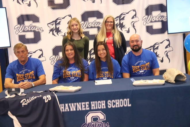 Shawnee High School senior catcher Carly Torbett (second from right) poses after signing a national letter-of-intent to play softball at Rose State College next season.