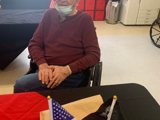Shawnee Colonial Estates celebrated Veterans Day with their veterans, including Robert Jensen and Freeman Whitlock, who enjoyed the cake provided by Frontier Hospice and the plaques provided by the local Veterans of Foreign Wars.