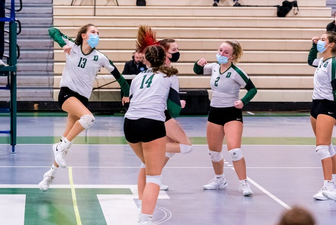 The Lady Indians celebrate a point in their matchup against Bridgewater-Raynham.  [RYAN FEENEY/STANDARD-TIMES SPECIAL/SCMG]