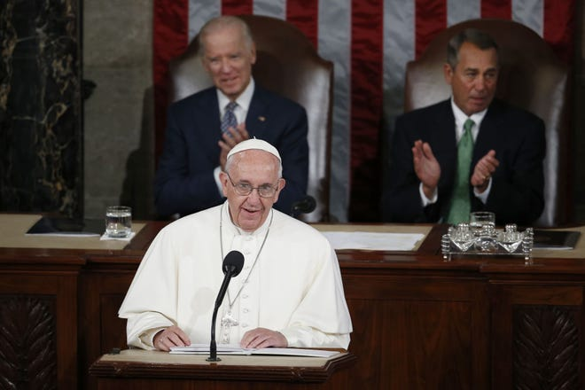 Pope Francis addresses a 2015 joint meeting of Congress on Capitol Hill in Washington, making history as the first pontiff to do so. Listening behind the pope are Vice President Joe Biden and House Speaker John Boehner of Ohio. President-elect Joe Biden, a lifelong Roman Catholic, spoke to Pope Francis on Nov. 12,  despite President Donald Trump refusing to concede.