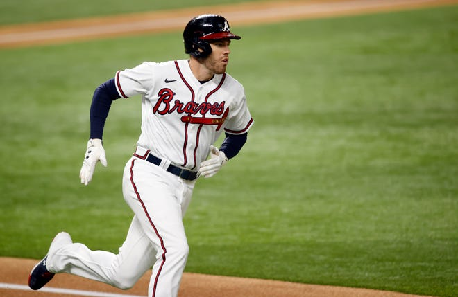 Braves first baseman Freddie Freeman recovered from COVID-19 to win the National League MVP award.