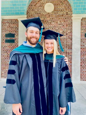 Amy Collins and her boyfriend, Wyatt Kurzejeski, on graduation day from the University of North Carolina Doctor of Physical Therapy program.