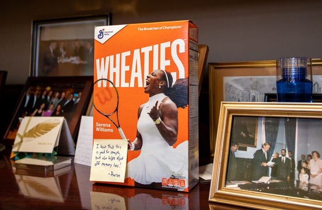 A box of Wheaties with a note from House budget chief Aaron Michlewitz was displayed on a shelf in Senate budget chairman Michael Rodrigues' office last week.