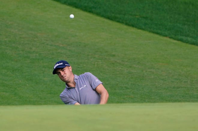Justin Thomas, who carded 66 in the first round, chips up onto the 10th green during the second round of the Masters on Friday.