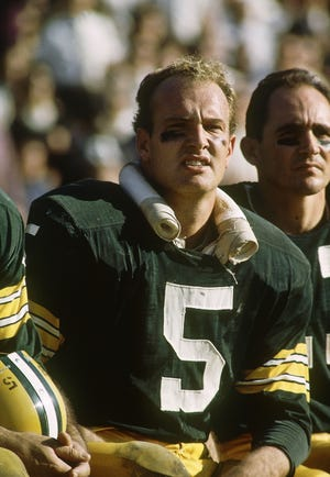 Paul Hornung, shown on the Packers bench during the 1964 season, has died at age 84.