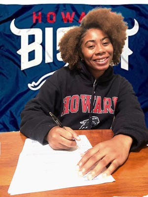 Jack Britt's Nyla Cooper signs a national letter of intent to play basketball at Howard University on Wednesday, Nov. 11, 2020.