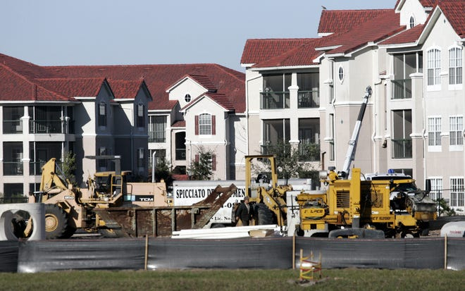 Construction crews build a new apartment complex next to an already sold out complex in Brandon.