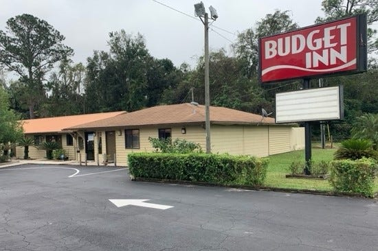 Alachua County commissioners approved buying the Budget Inn, on Southwest 13th Street just south of Williston Road, to use for housing people who are homeless.