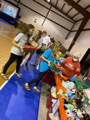 Riverbend Baptist Church hosted a Operation Christmas Child packing party to  fill shoe boxes for the mission effort that reaches out to children in impoverished countries.