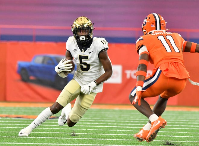 Wake Forest receiver Jaquarii Roberson, left, makes a move on Syracuse defensive back Ja'Had Carter in a game last month.