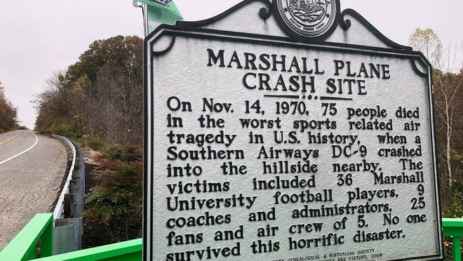 A memorial plaque is displayed at the site of a 1970 plane crash that killed 75 people, including 36 Marshall football players Oct. 24, 2020, near Huntington, W.Va. The Nov. 14, 1970 crash remains the worst sports disaster in U.S. history.