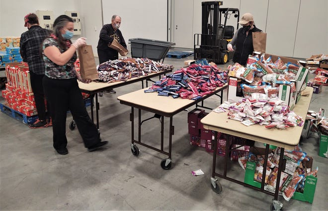A multi-station assembly line set-up allowed for quick packaging of the food kits.