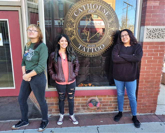 From left, Maddelyn Tannehill, Katrina Gonzales and Addy Van Matre are the owners and operators of Cathouse Tattoo.