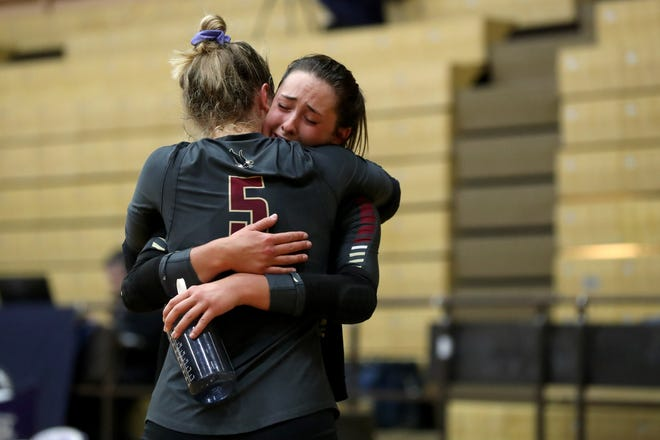 Watterson's Sophie Mangold and Sydney Taylor (5) console each other following a three sets to one loss to Parma Padua in a Division I state semifinal Nov. 13 at Vandalia Butler. The Eagles finished 17-7.