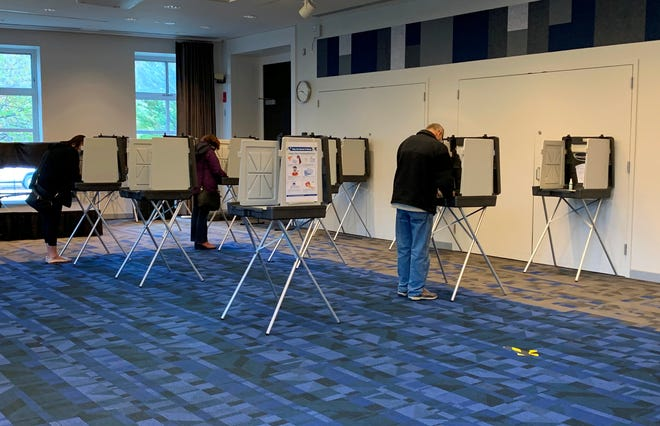 Voters cast their ballots on Nov. 3, 2020, at the Newton Free Library.