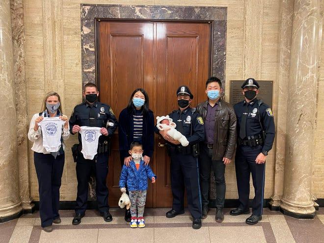 Medford police officers Dean Bruno, Matthew Nestor and Benjamin Franzese helped Medford resident Nan Qin deliver her baby, Riley, on Oct. 8.