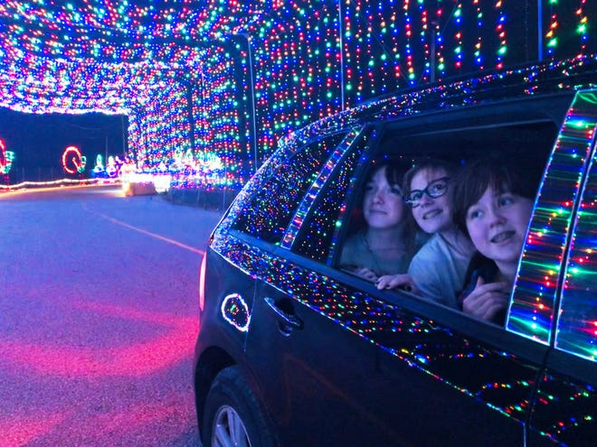 Taking in the lights at a preview of the Magic of Lights drive-through experience being hosted by Gillette Stadium this holiday are, from left, Jazzlyn Johnson, 15; Molly Arnold, 14, and Kathryn McCarron, 14, all of North Attleborough. The show will run nightly through Jan. 2.