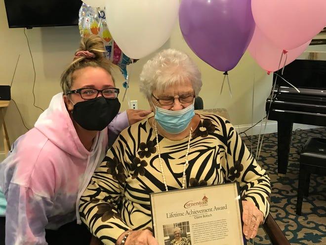 Claire Botsch celebrates her Lifetime Achievement award with granddaughter Danielle McNamara. [Courtesy Photo)