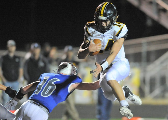 Cisco quarterback Hunter Long jumps into the end zone for a touchdown against Stamford in a Class 2A Division I bi-district playoff Thursday at Bulldog Stadium in Clyde.