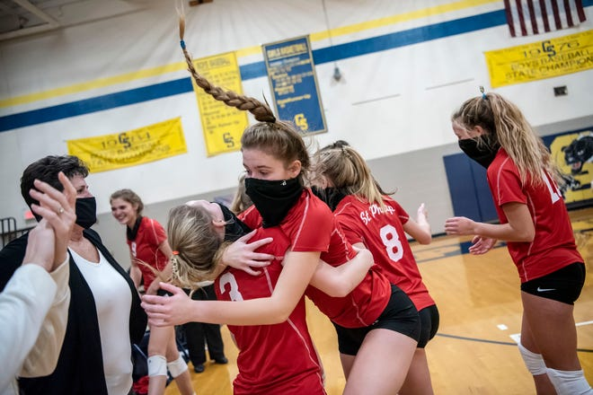 St. Philip sophomores Kate Doyle (3) and Maddie Hoelscher (1) embrace after winning the Division 4 regional final against Athens on Thursday, Nov. 12, 2020 at Climax-Scotts Jr./Sr. High School in Climax, Mich.